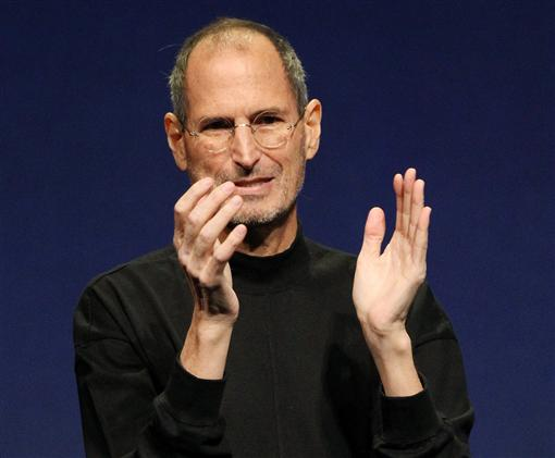 Apple Inc. CEO Steve Jobs applauds at the conclusion of the launch of the iPad 2 on stage during an Apple event in San Francisco