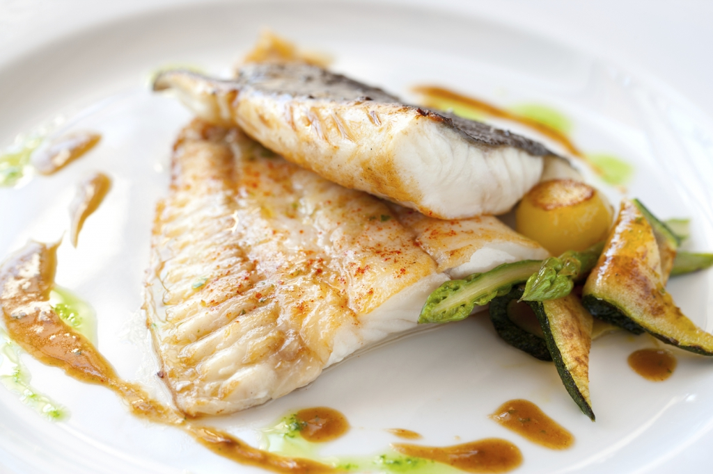 Close up of Grilled turbot fish with vegetables.