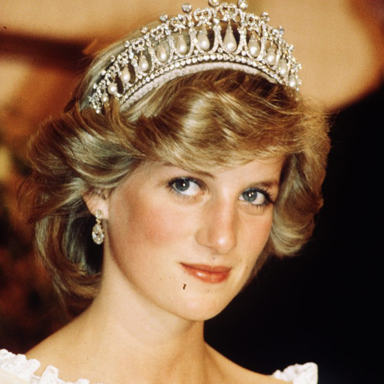 AUCKLAND, NEW ZEALAND - APRIL 29: Diana, Princess of Wales, wearing a cream satin dress by Gina Fratini with the Queen Mary Cambridge Lover's Knot Tiara and diamond earrings attends a banquet on April 29, 1983 in Auckland, New Zealand. (Photo by Anwar Hussein/WireImage)