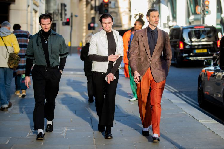 LONDON, ENGLAND - JANUARY 04: Guests and Richard Biedul wearing brown blazer, black button shirt, rust brown pants seen outside Edward Crutchley during London Fashion Week Men's January 2020 on January 04, 2020 in London, England. (Photo by Christian Vierig/Getty Images)
